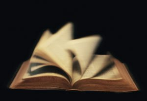 The pages of a book turning quickly